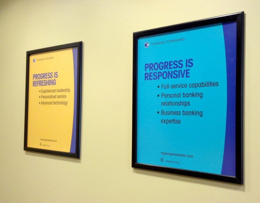 Progress Bank branch posters before the redesign.